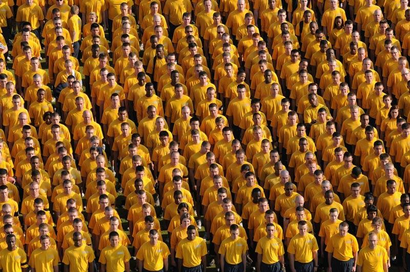 Image of a bunch of people wearing yellow t-shirts.
