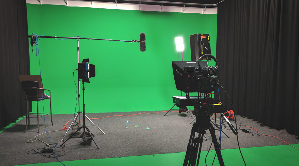 Image of a video interview setup in front of a green screen